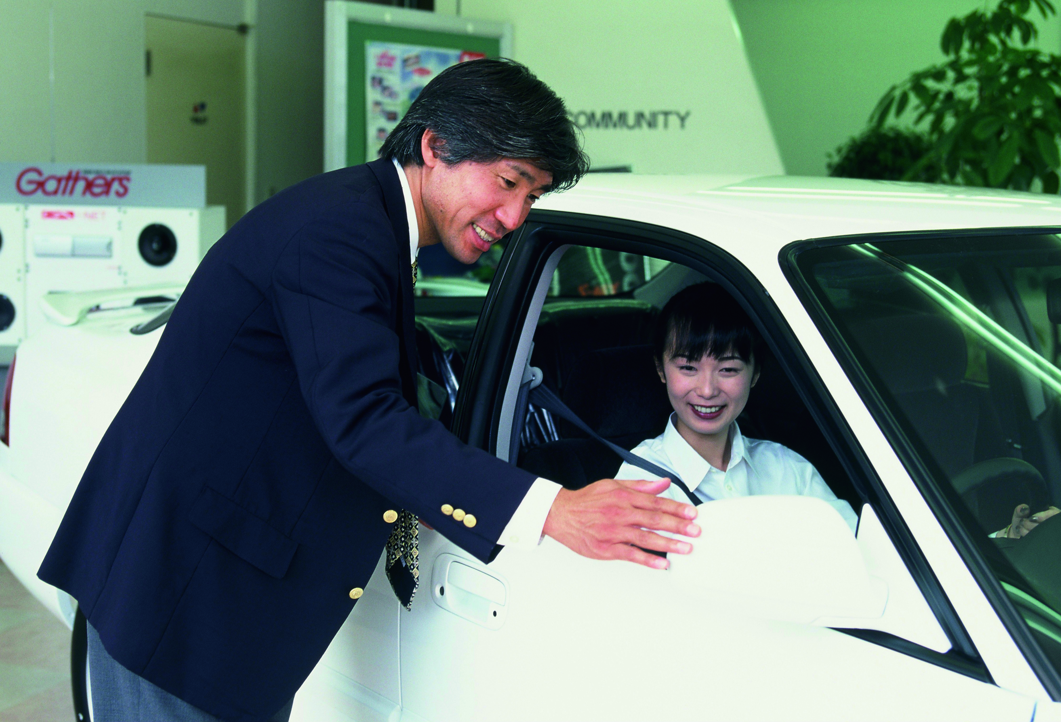 Safety Coordinator offering advice to customers at a	  dealership location when the system was first introduced