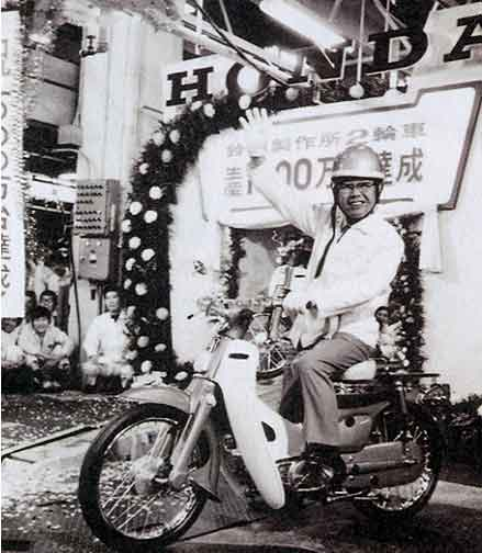 Soichiro Honda sits astride the Super Cub with a big smile on his face. By 1971, motorcycle production at Honda's Suzuka Plant had passed the 10 million units mark.