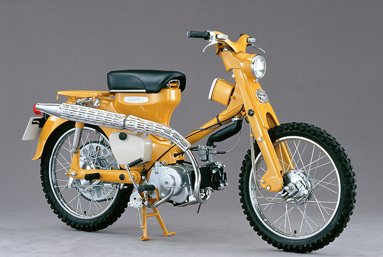 The 1963 C105H. Outfitted with block tires, double sprockets and a raised muffler to enhance its off-road riding performance, this model effectively showed a new side to the Super Cub.